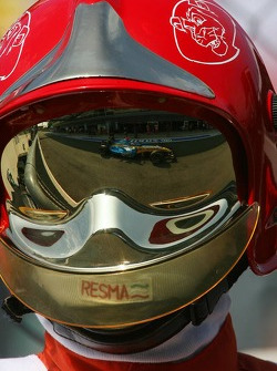 Fernando Alonso reflection in fire marshals helmet