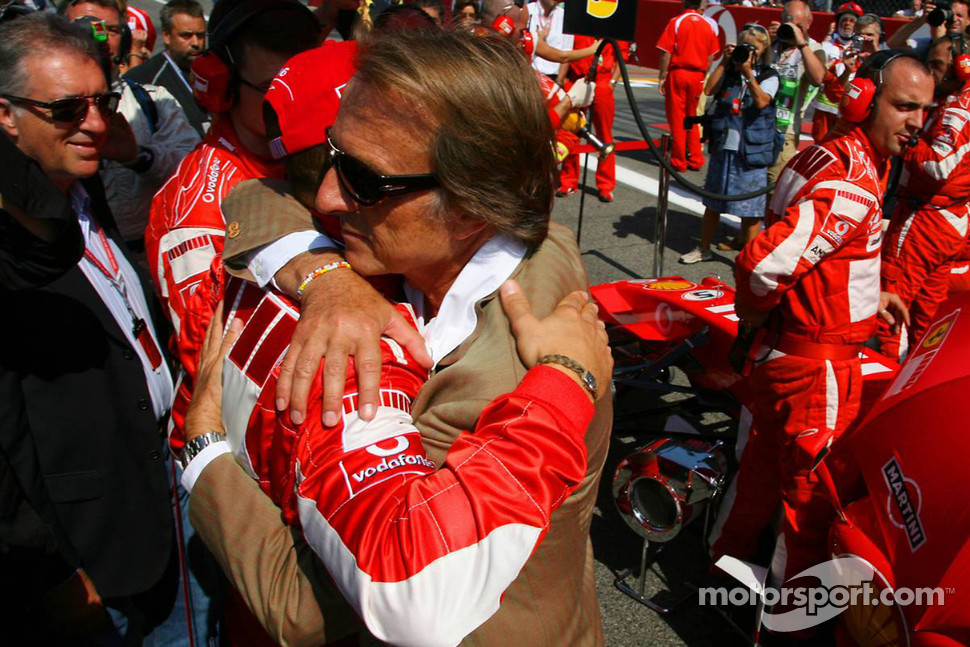 Luca di Montezemolo hugs Michael Schumacher