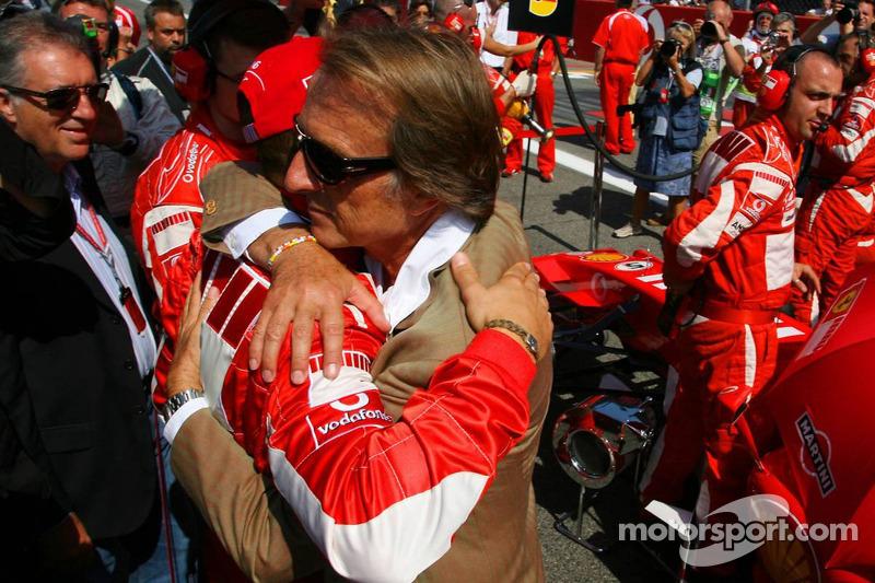 Luca di Montezemolo hugs Michael Schumacher