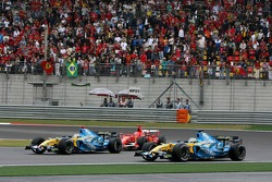 Fernando Alonso leads Michael Schumacher and Giancarlo Fisichella