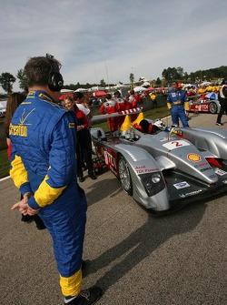 A Creation Autosportif team member has a close look at the #2 Audi Sport North America Audi R10 TDI Power