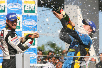 Podium: champagne for Fernando Alonso and Jenson Button