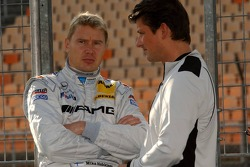 Mika Hakkinen talks to his race engineer Axel Randolph