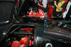 Michael Schumacher in his own Ferrari FXX road car and Felipe Massa