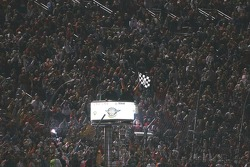 Tony Stewart celebrates his victory with the crowd at Texas Motor Speedway