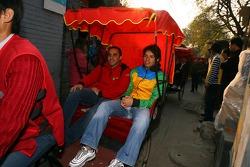 Tuka Rocha takes a ride in a rickshaw with Khalil Beschir