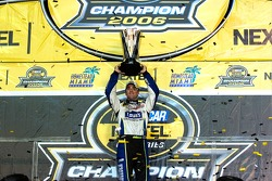 Championship victory lane: 2006 NASCAR Nextel Cup champion Jimmie Johnson hoist the Nextel Cup