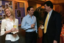 Chandra Johnson, 2006 NASCAR NEXTEL Cup Series champion Jimmie Johnson and NASCAR President Mike Helton talk prior to the champion's welcome dinner at the Waldorf-Astoria Hotel