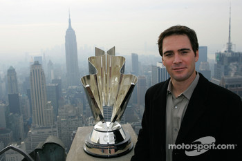 Jimmie Johnson poses for a photo on the Top of the Rock Observation Deck at Rockefeller Center with the Empire State Building in the background