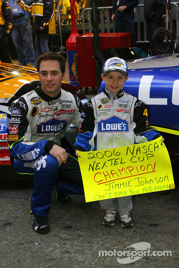 Jimmie Johnson poses with a young NASCAR fan in Times Square on Wednesday