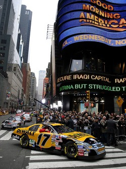 The Ford Fusion driven by Matt Kenseth helps lead the pack of Nextel Cup cars through Time Square