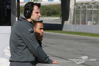 Lewis Hamilton watches the action on track