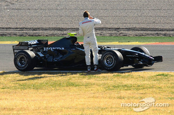 Jenson Button stopped on track