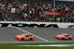 Tony Stewart takes the checkered flag ahead of Dale Earnhardt Jr.