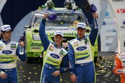 Podium: winners Mikko Hirvonen and Jarmo Lehtinen