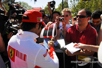 Felipe Massa, Scuderia Ferrari, signs autographs