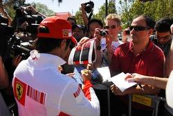 Felipe Massa, Scuderia Ferrari, signs autographs