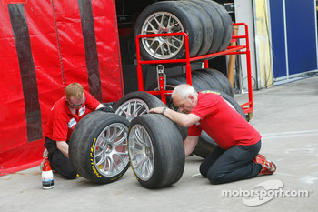 Team members prepare tires