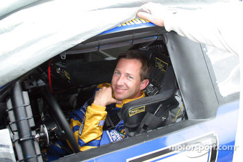 John Andretti waits out the rain delay in his car