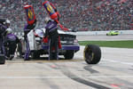 A tire gets loose during a Pitstop for David Gilliland