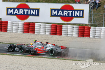 Start: Fernando Alonso, McLaren Mercedes, MP4-22 in the gravel at turn 1