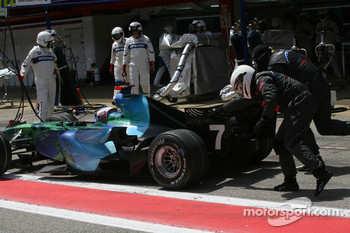 Jenson Button, Honda Racing F1 Team, RA107 gets a push after his pitstop