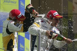 Timo Glock celebrates victory with Javier Villa and Lucas di Grassi
