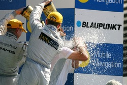 Podium: Gerhard Ungar, Chief Designer AMG, gets a champagne shower
