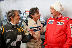 Alain Prost, with Nelson Piquet, and Niki Lauda, Mercedes Non-Executive Chairman at the Legends Parade