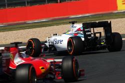 Felipe Massa, Williams FW37 leads Sebastian Vettel, Ferrari SF15-T
