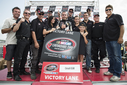 Kevin Lacroix celebrates his victory in the Victory Lane
