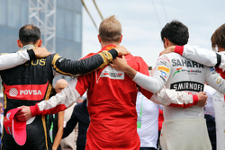 The drivers observe the tribute to Jules Bianchi on the grid