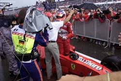 Michael Schumacher greets race winner Rubens Barrichello, Ferrari in parc ferme