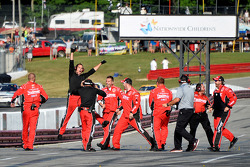 JR Motorsports crew members celebrate Regan Smith's victory