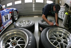 Team member prepares the tires