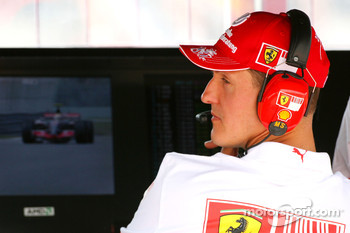 Michael Schumacher, Scuderia Ferrari, Advisor as Lewis Hamilton, McLaren Mercedes, MP4-22 passes on the TV Moniter