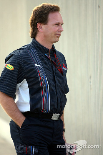 Christian Horner, Red Bull Racing, Sporting Director arrives at the track and reads The Red Bulletin
