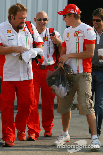 left to right, Gino Rosato, Scuderia Ferrari, Security, Mark Arnell, Personal trainer to Kimi Raikkonen and Kimi Raikkonen, Scuderia Ferrari