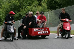Raphael Matos and James Hinchcliffe ride around the track