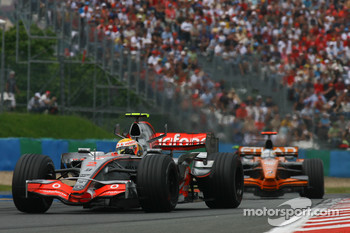 Lewis Hamilton, McLaren Mercedes, MP4-22 and Adrian Sutil, Spyker F1 Team, F8-VII