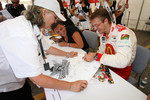 Sbastien Bourdais shares a laugh with Katherine Legge and a fan