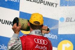 Podium: Mattias Ekström, Audi Sport Team Abt Sportsline, spraying champagne