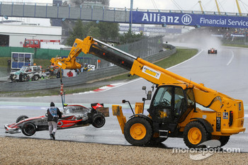 Lewis Hamilton, McLaren Mercedes, MP4-22 is lifted back onto the circuit