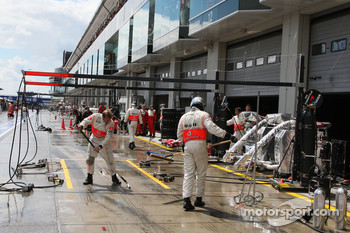 McLaren Mercedes, sweep their pit box
