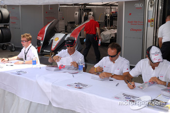 Audi Sport North America drivers Allan McNish, Rinaldo Capello, Marco Werner, and Emanuele Pirro