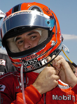 Helio Castroneves secures the helmet