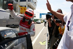 Pole winner Timo Scheider celebrates