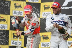 Podium: race winner Lewis Hamilton with third place Nick Heidfeld