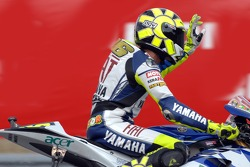 Seventh place Valentino Rossi waves