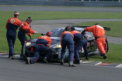 Marshalls attempt in vain to push #59 Team Modena Aston Martin DBR9: Antonio Garcia, Christian Fittipaldi backwards off the curb